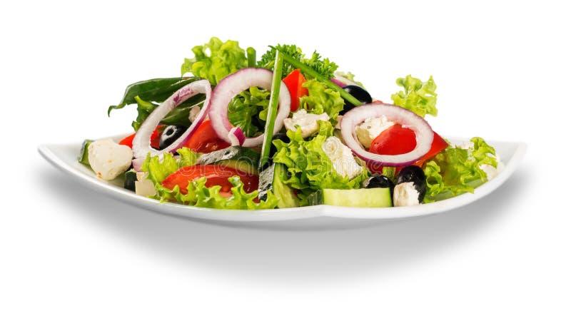 Свежий вкусный vegetable салат в шаре на белизне стоковое изображение