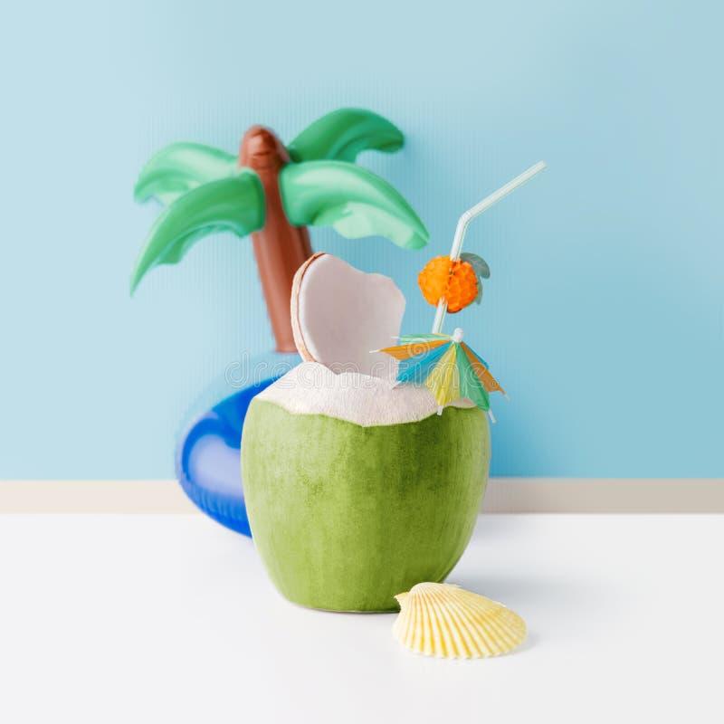 Свежий кокос на пастельной голубой предпосылке стоковые изображения rf
