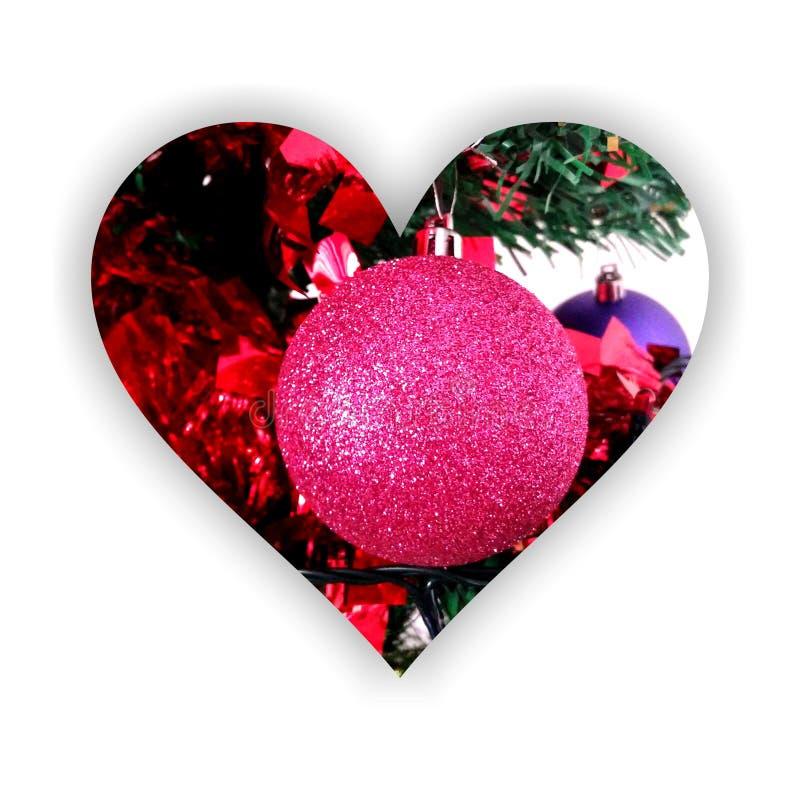 Сверкная безделушка рождества внутри формы сердца стоковые изображения