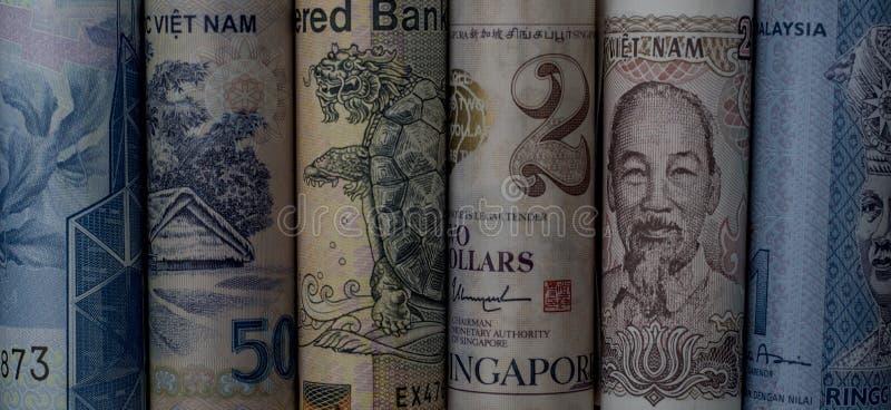Свернутые азиатские примечания денег стоковая фотография