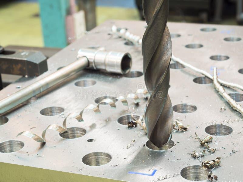 Сверля стальная пластина стоковые изображения rf