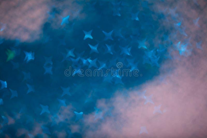 Света абстрактного bokeh звезды defocused голубые стоковые фото