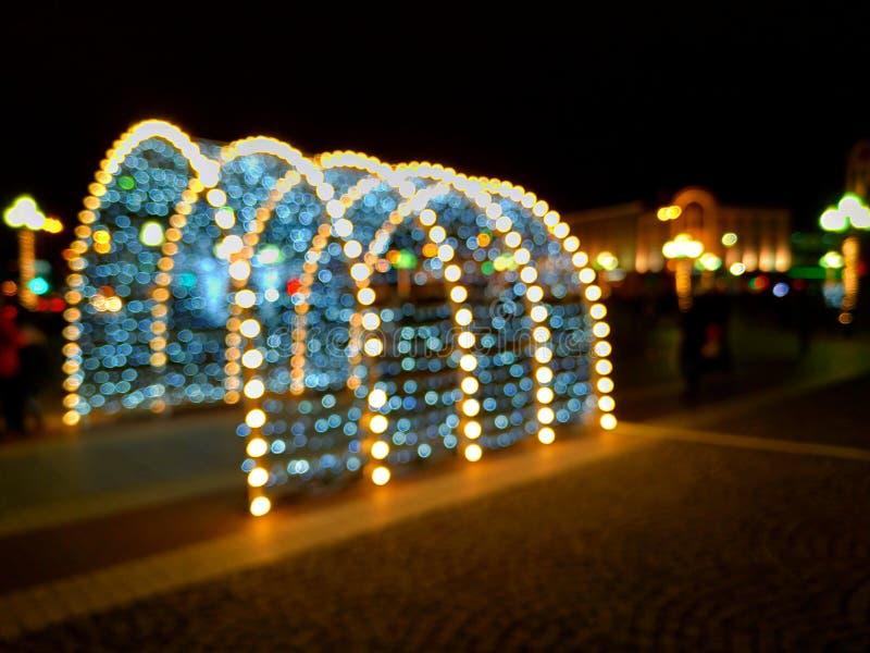 Света запачкали предпосылку bokeh время конца рождества предпосылки красное вверх стоковое фото rf