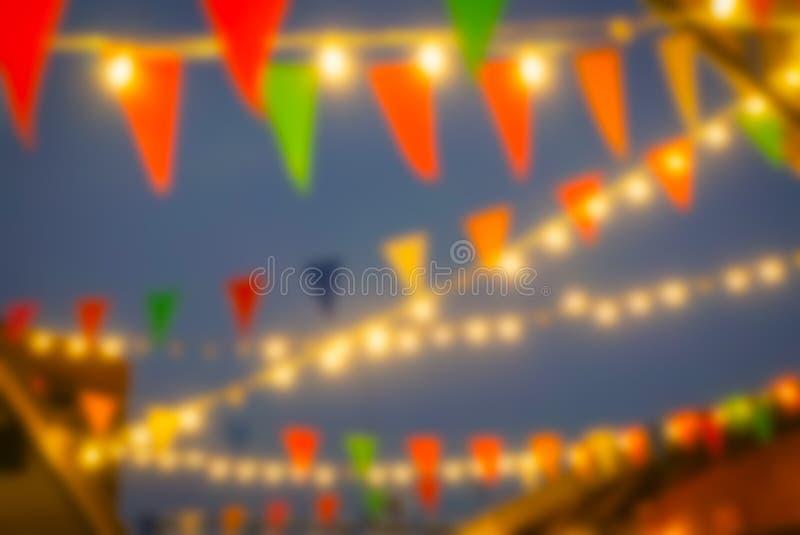 Света запачканные конспектом рынка ночи стоковые изображения