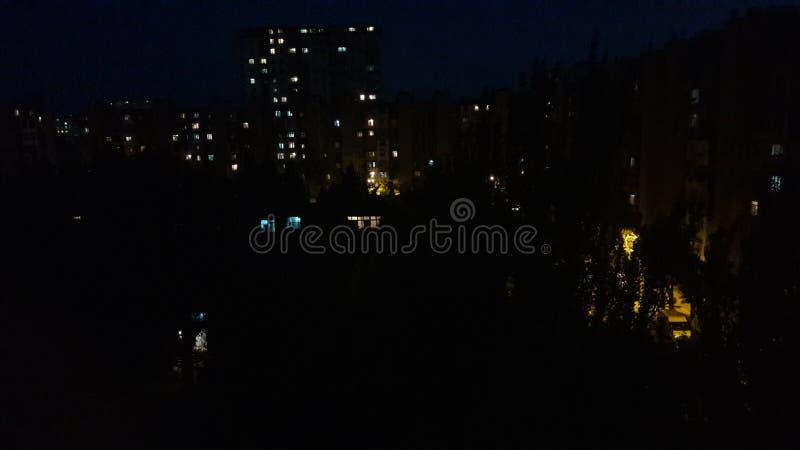Света ночи вечера города слабые стоковое изображение