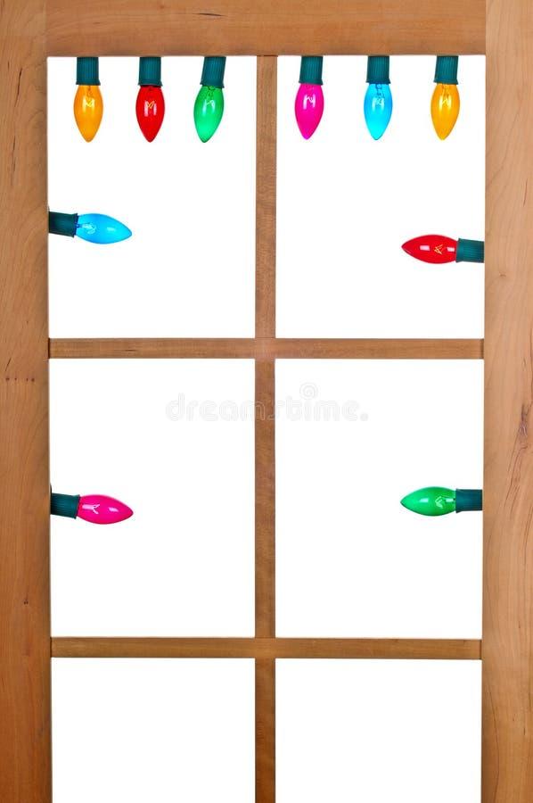Света рождества в окне стоковая фотография