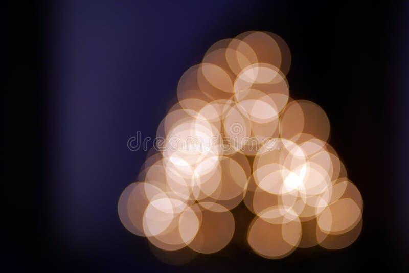 Света рождества на запачканной рождественской елке стоковые фотографии rf