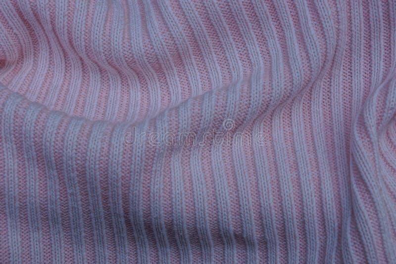 Светлый - материал розовой текстуры ткани шерстяной части свитера стоковые изображения