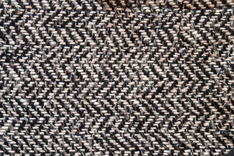 Светлый - серая ткань шерстяных или одежды из твида для предпосылки grunge стоковое изображение