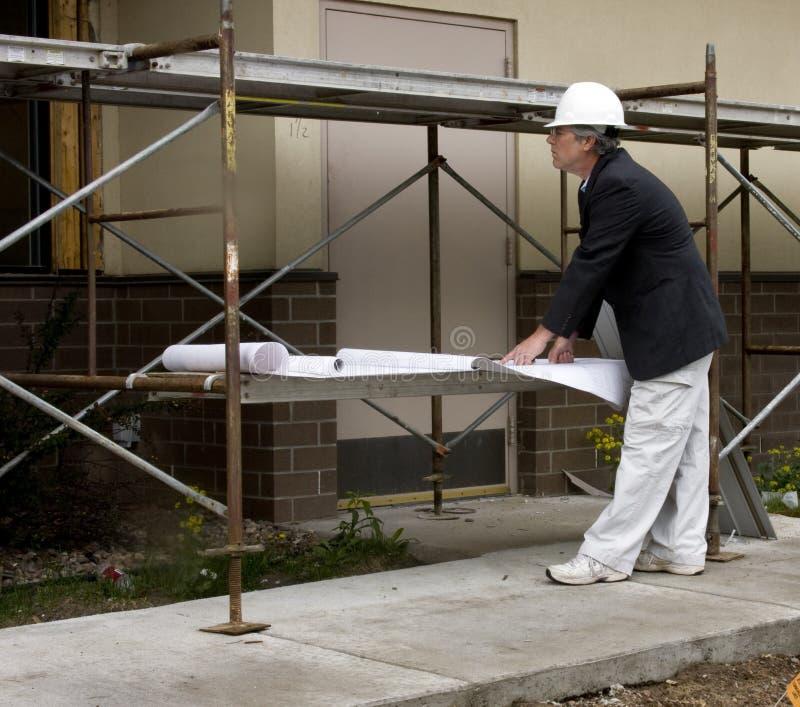 светокопии архитектора конструируя карандаш человека руки стоковые фото