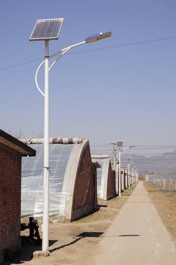 Свет и парник солнечной энергии стоковое фото