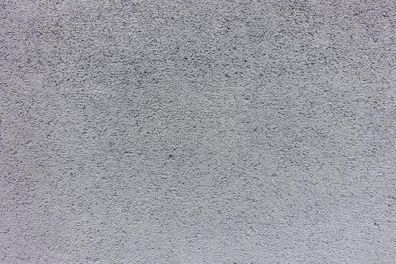 Свет - серая грубая покрашенная текстура бетонной стены стоковая фотография