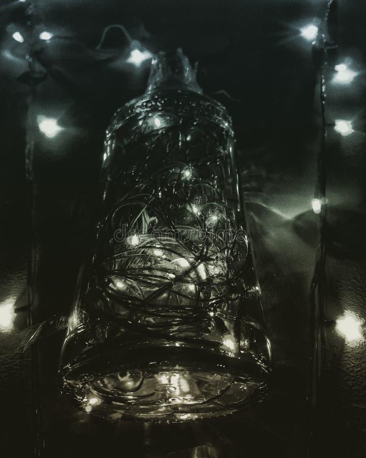 Свет с бутылкой стоковые фото
