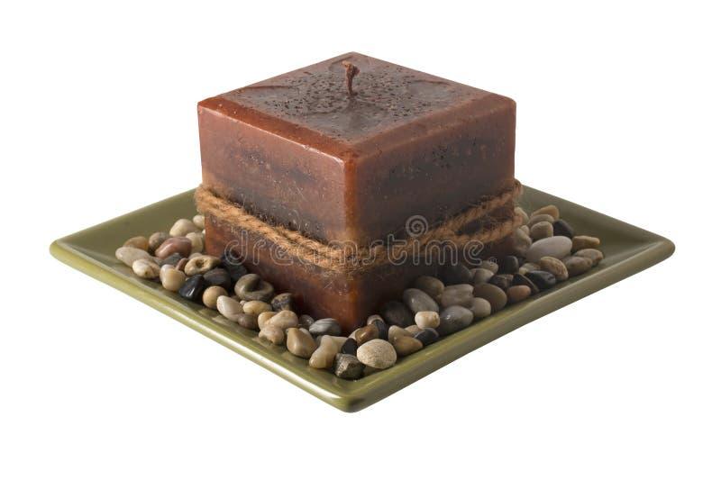 Свеча на плите с камнями - unlit стоковое изображение rf