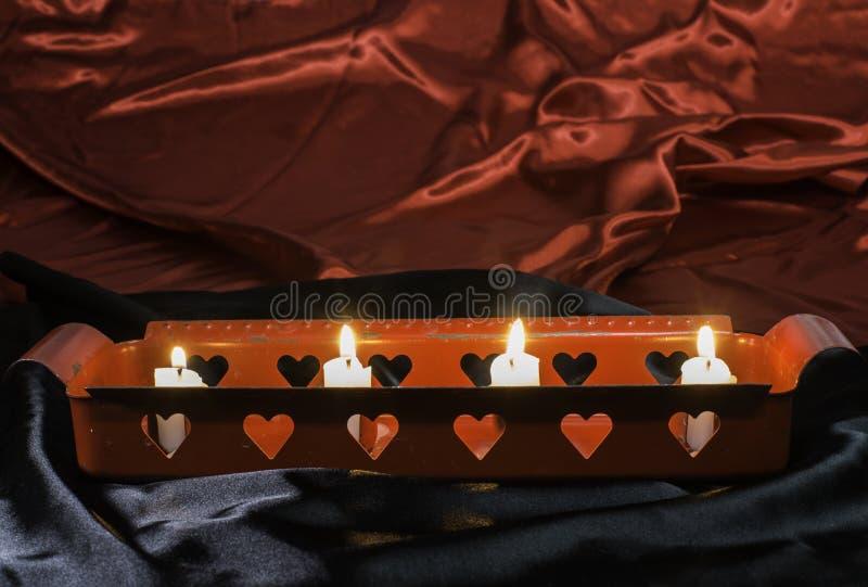 Свечи и формы сердца стоковые изображения