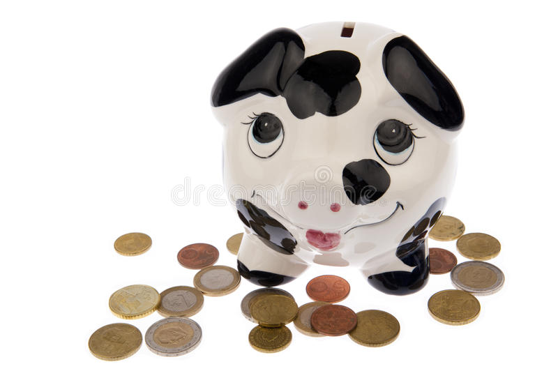 Свинья на кровати монеток евро стоковые изображения