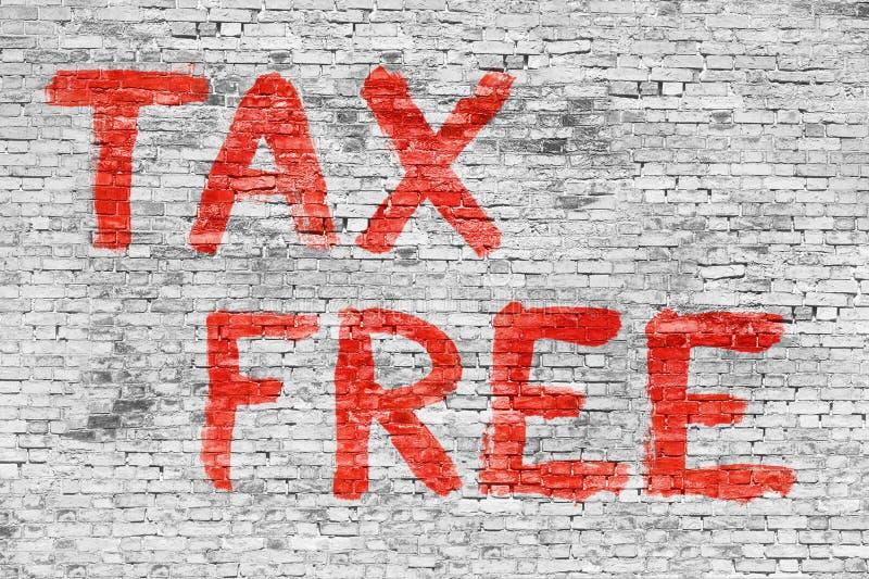Свободная налога покрашенная над белой кирпичной стеной стоковая фотография