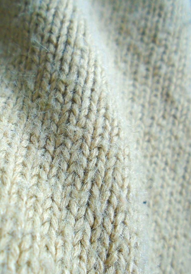 Связанная предпосылка свитера шерстяная поверхностная стоковая фотография