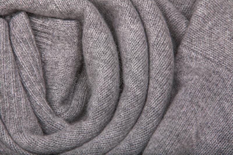 Связанная серым цветом текстура шерстей стоковые изображения