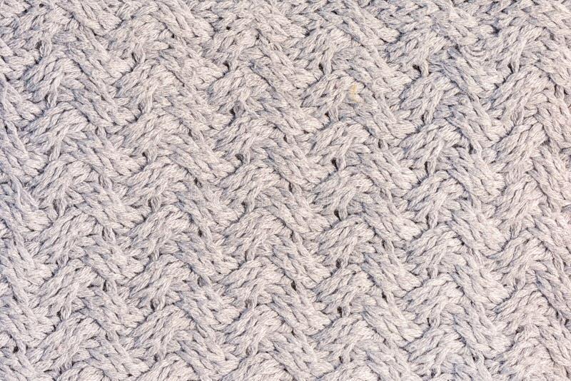 Связанная текстура с необыкновенным концом-вверх картины Ткань шерстей Серая предпосылка для планов стоковое изображение