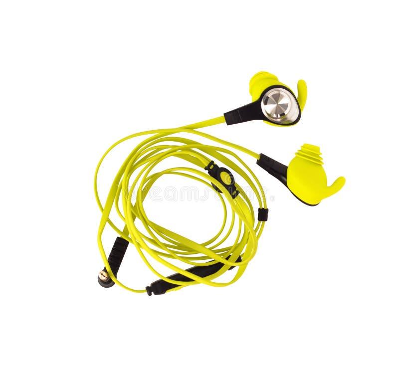Связанное проволокой изолированное headphonesn earbud спорта стоковая фотография rf