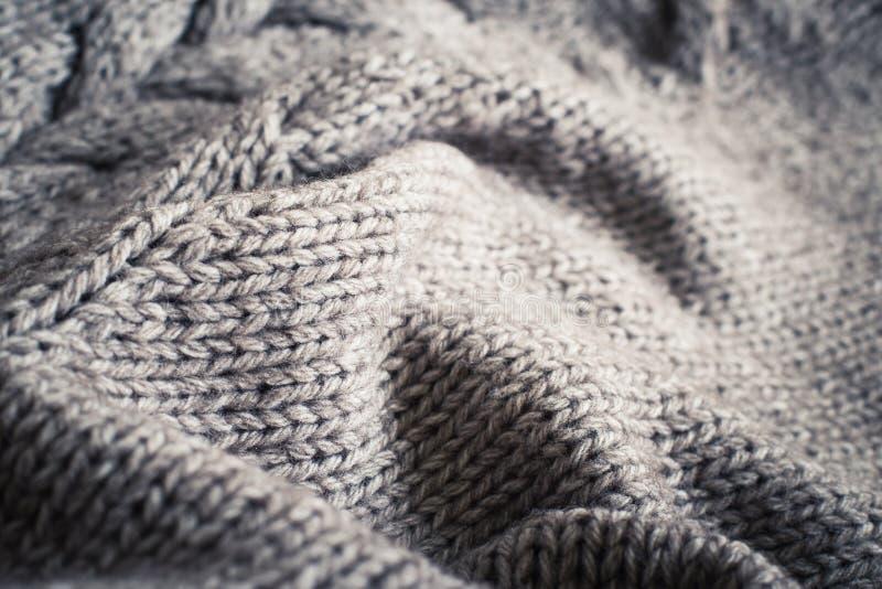 Связанный конец текстуры шерстей ткани вверх стоковое изображение rf