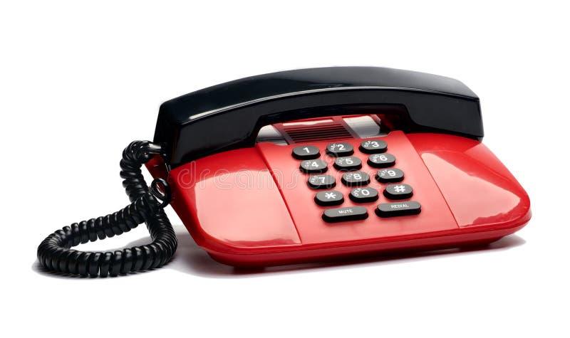 связанный проволокой телефон изолированный настольным компьютером стоковые изображения rf