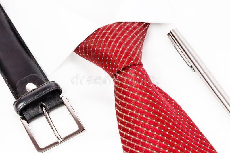 Связь завязала двойное Виндзор с ручкой и поясом стоковая фотография