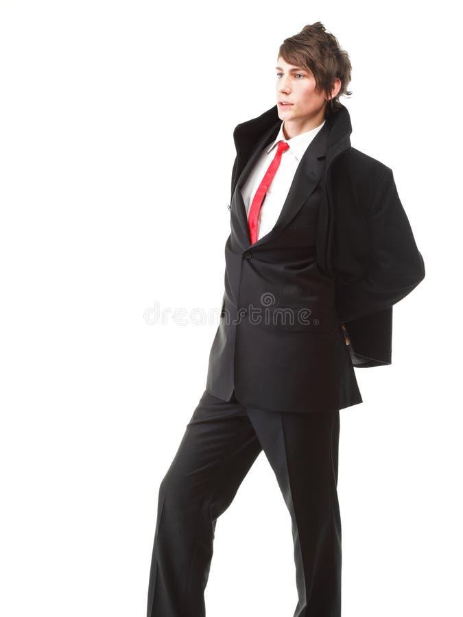 Связь молодого костюма черноты бизнесмена вскользь на белой предпосылке стоковые изображения rf