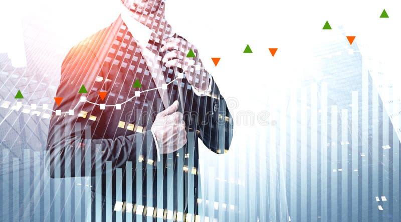 Связь отладки бизнесмена, диаграмма фондовой биржи стоковое фото rf