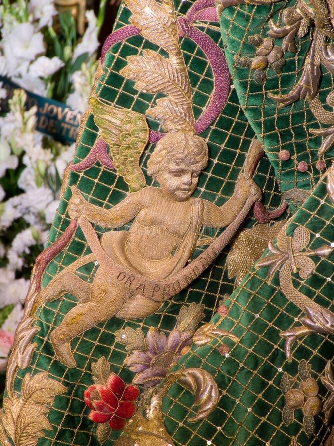 Святая неделя в Севилье, деталь хламиды, девственница надежды Macarena стоковое изображение