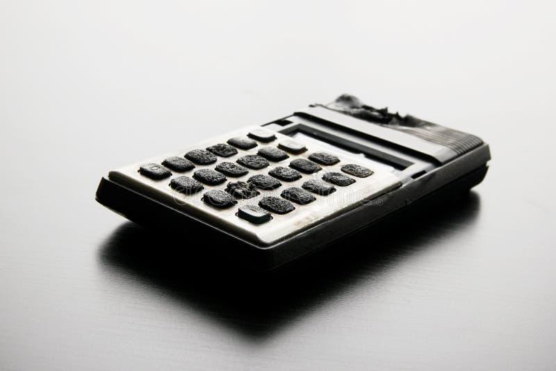 Сгорели калькулятор стоковое изображение rf