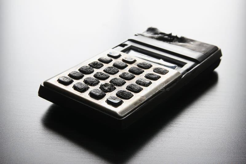Сгорели калькулятор стоковое изображение