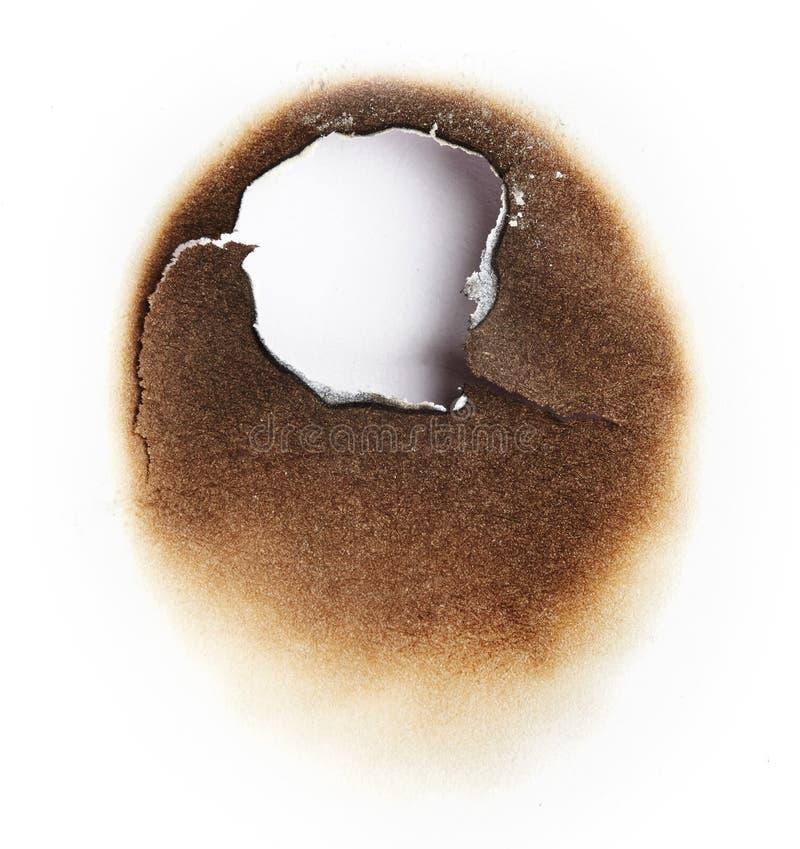 Сгорели отверстие бумаги стоковая фотография