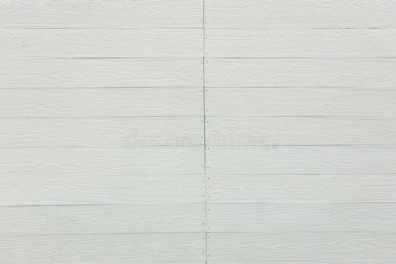 Сделанная по образцу белизной деревянная предпосылка стены стоковые фото
