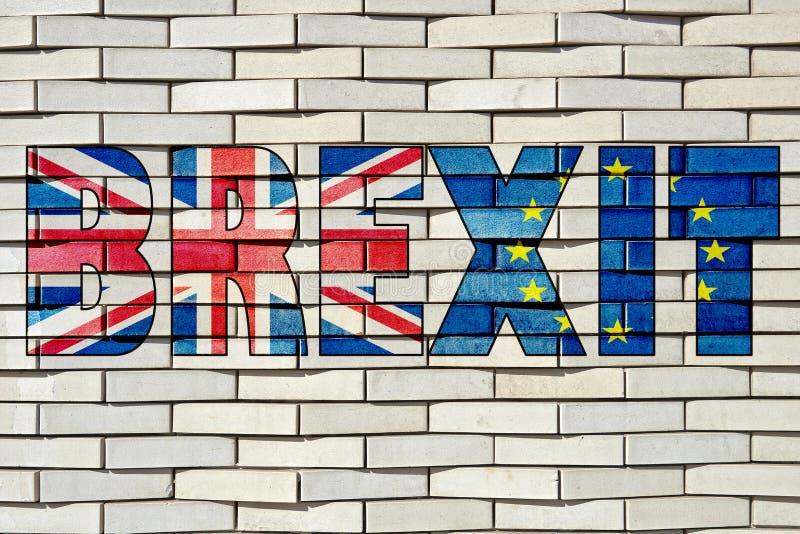 Сделанные по образцу белые кирпичи преграждают стену с письмами Brexit стоковая фотография