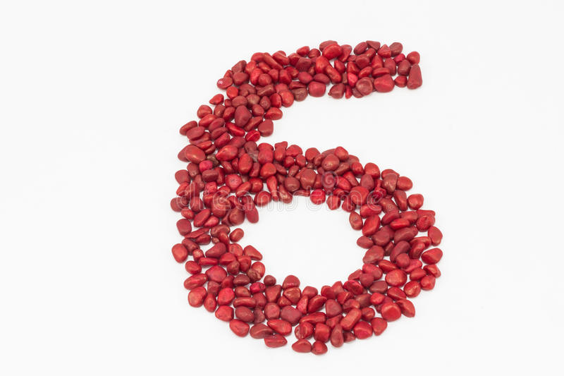 6, сделанный красными камнями стоковая фотография
