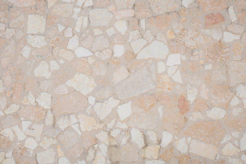 Сделанный по образцу каменный пол с скачками сломанными каменными битами стоковые фото