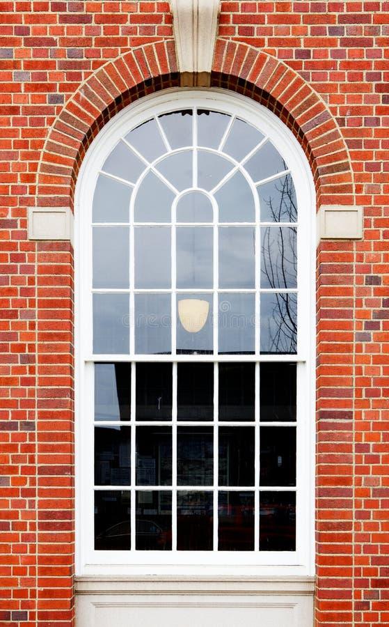 сдобренное окно кирпичной стены стоковое фото rf