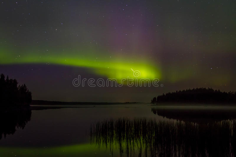 Северное сияние в северной Скандинавии стоковое изображение