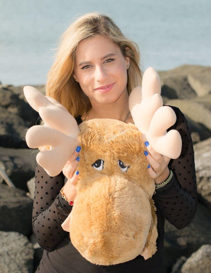 Северный олень на море стоковое изображение