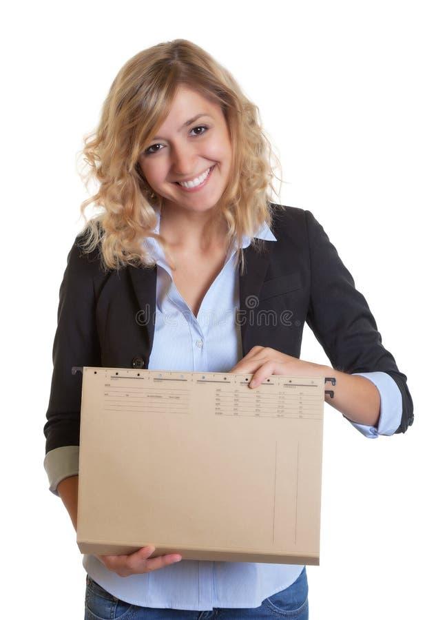 Секретарша с искать голубого блейзера и файла документ стоковые изображения