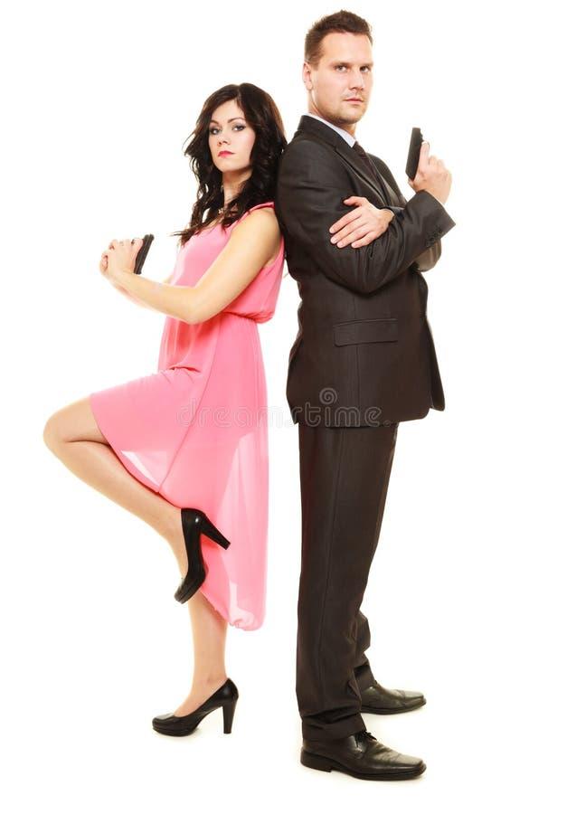 Секретное исследование с человеком и женщиной стоковое фото