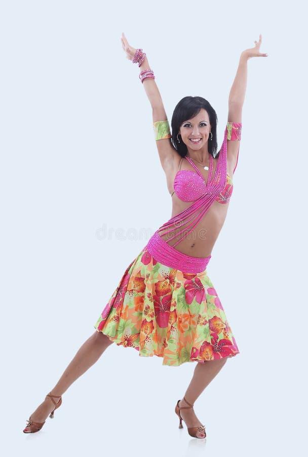 Сексуальная девушка танцора латиноамериканца в действии Изолировано на белизне стоковые фото