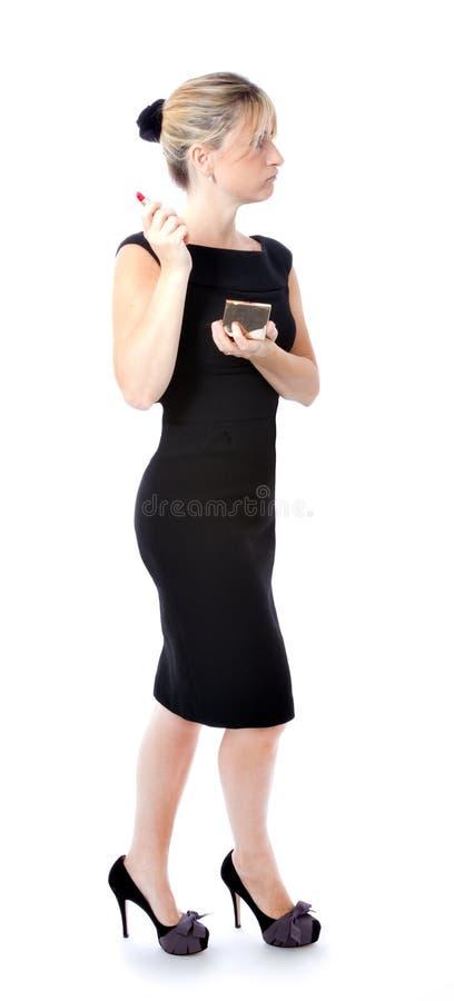 Сексуальная одетьнная чернота женщины стоковое изображение rf
