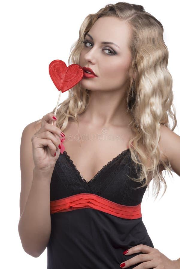 Сексуальная девушка с леденцом на палочке стоковые изображения