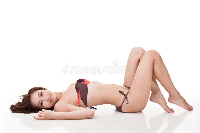 Сексуальная женщина бикини стоковое изображение