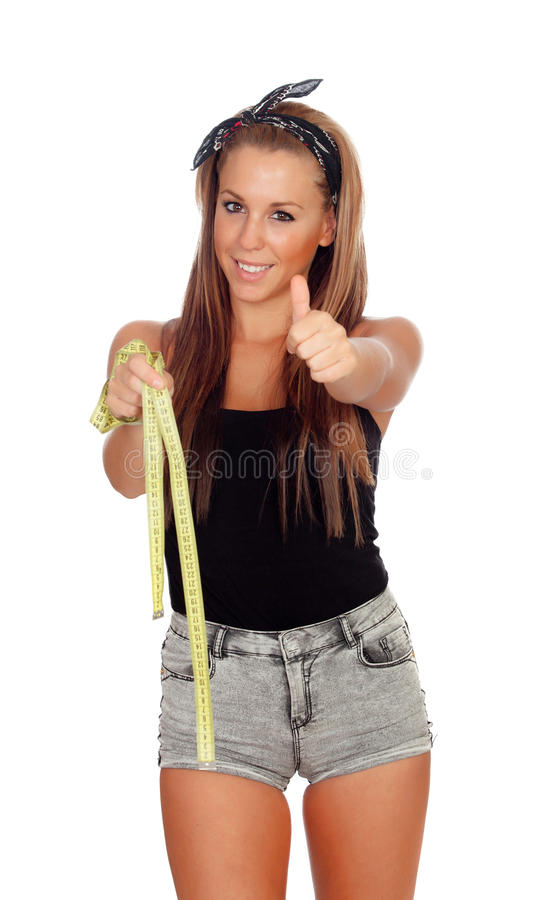 Сексуальная женщина в джинсах замыкает накоротко с рулеткой стоковое фото rf