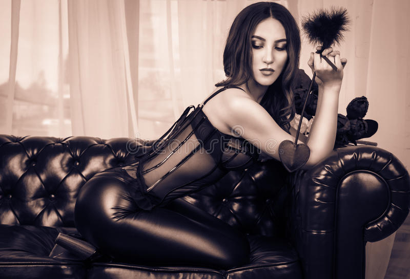 Sexy beautiful girl lingerie on leather stock photo