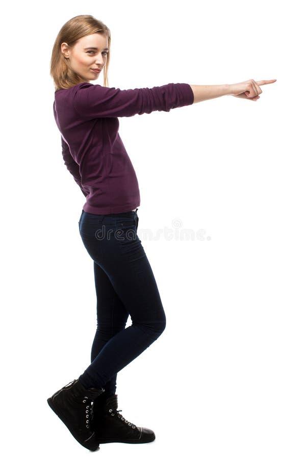 Сексуальная молодая женщина указывая вперед стоковые фотографии rf